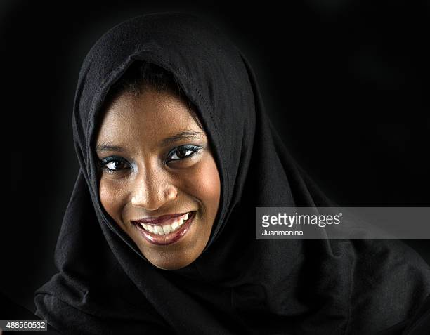 smiling muslim teenage girl - nigerian girls stock photos and pictures