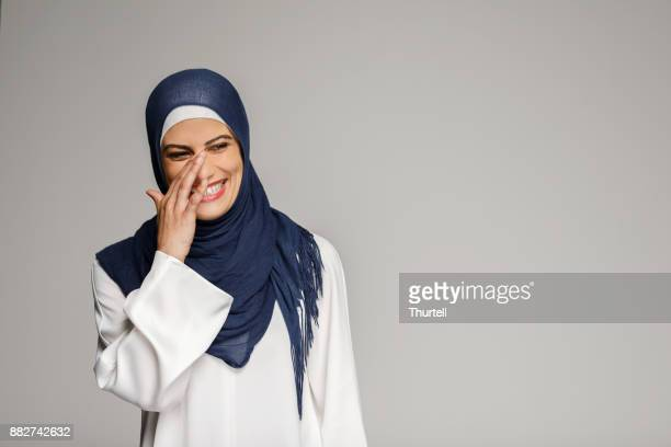 smiling muslim woman wearing hijab - wedding veil stock photos and pictures