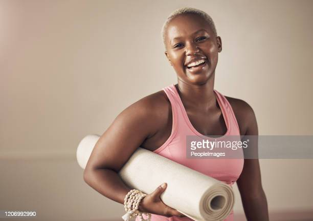 smiling my way out the yoga studio - yogi stock pictures, royalty-free photos & images