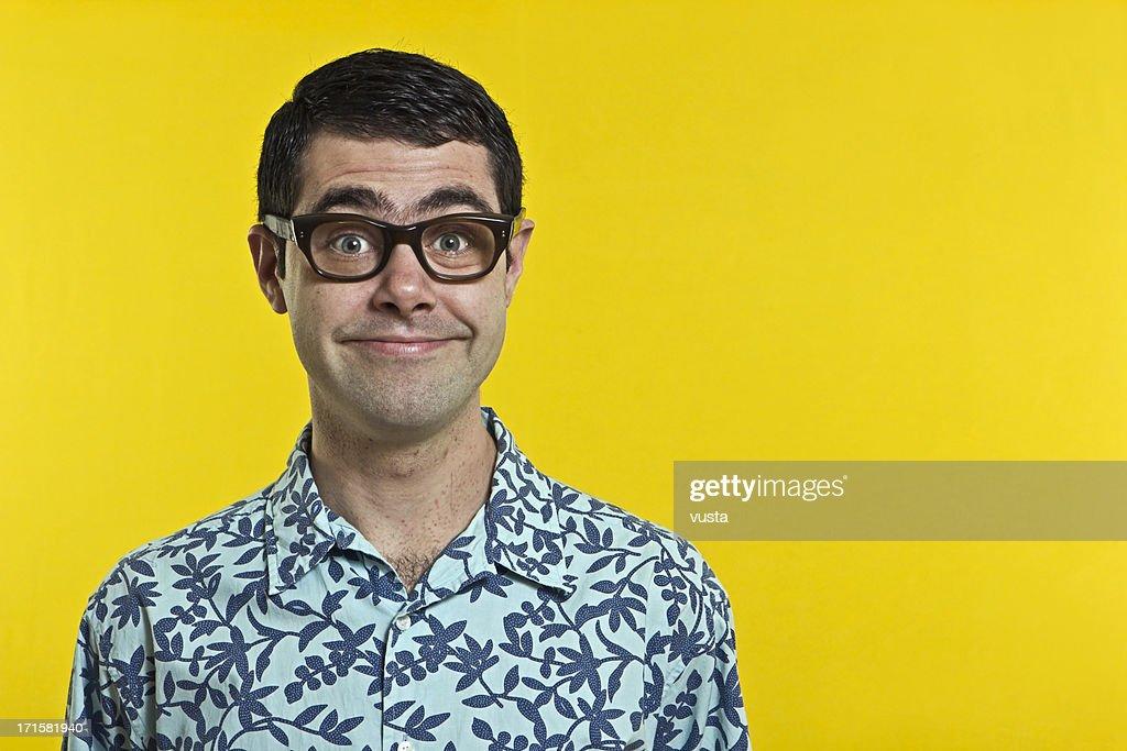 smiling nerd boy with hawwai shirt : Stock Photo