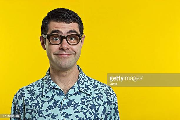 smiling nerd boy with hawwai shirt - thick rimmed spectacles stock photos and pictures