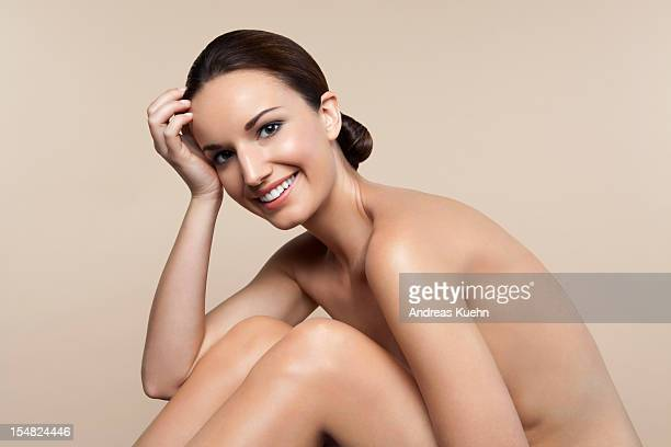 smiling nude young resting head on hand. - セミヌード ストックフォトと画像