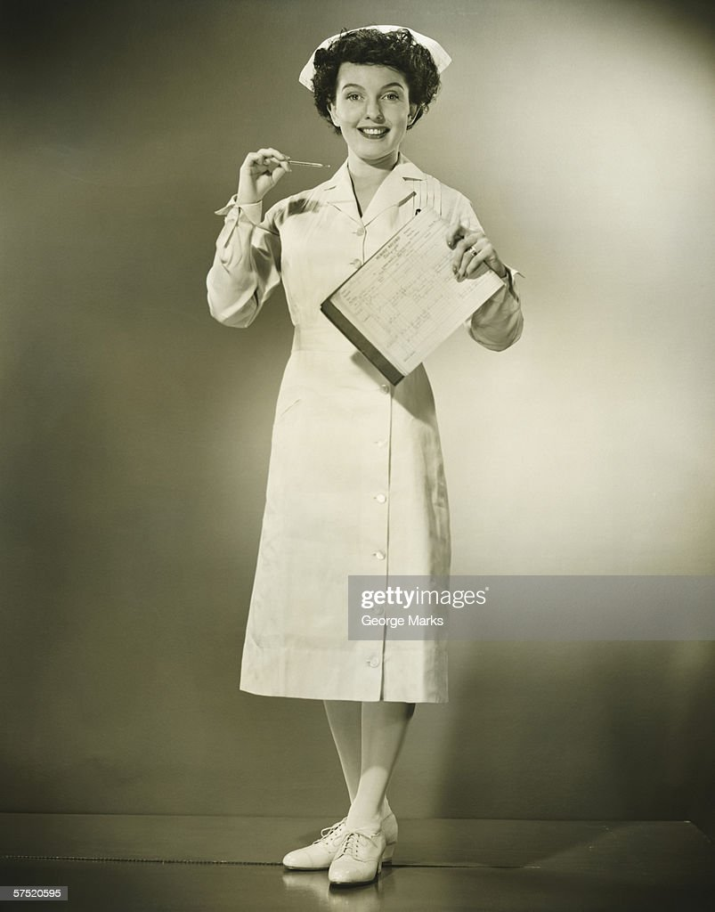 Closeup Of A Happy Female Nurse Smiling High-Res Stock