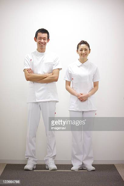 smiling nurses - nurse and portrait and white background and smiling and female and looking at camera stock pictures, royalty-free photos & images
