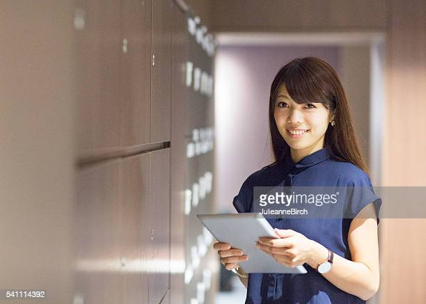 Smiling office worker with digital tablet
