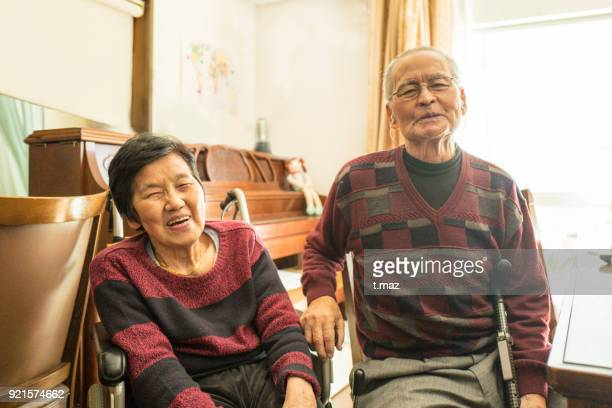 A smiling old couple.