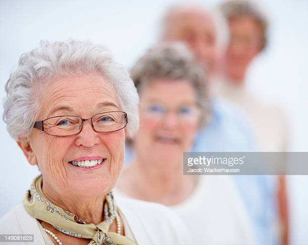 Smiling old people standing in a line