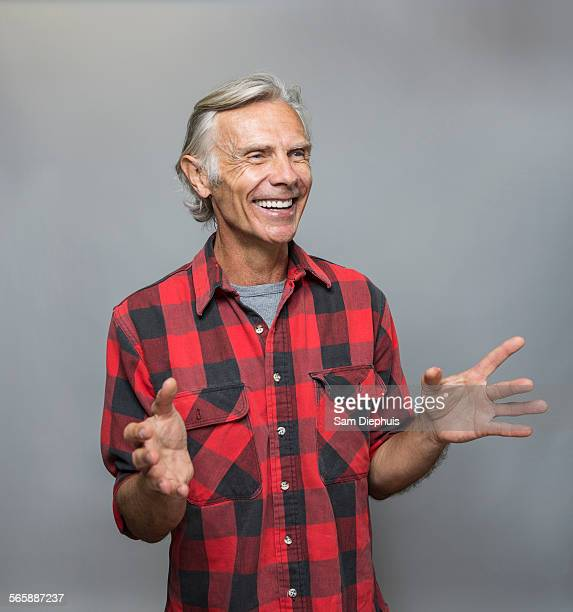smiling older caucasian man gesturing - 60 64 years stock pictures, royalty-free photos & images