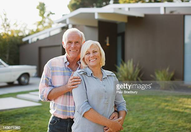Smiling older couple standing outdoors