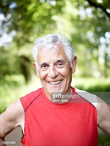 smiling older man standing outside - only senior men stock pictures, royalty-free photos & images