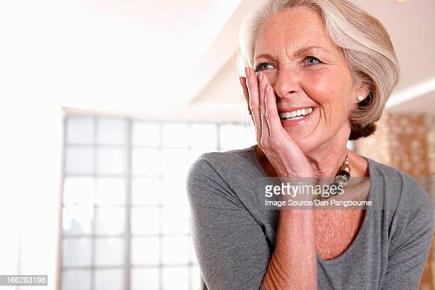 Smiling older woman gasping