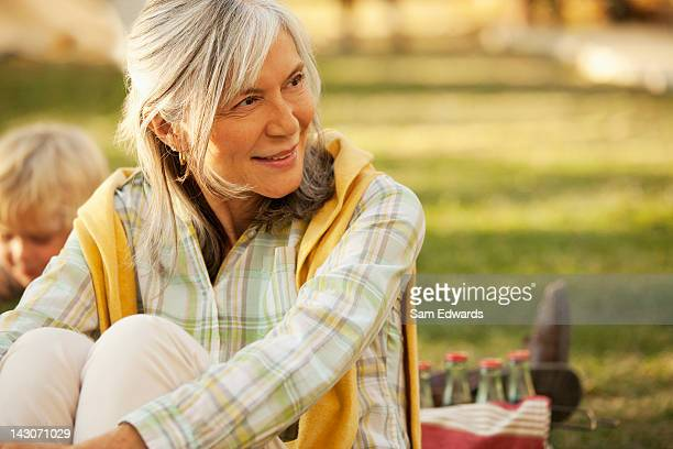 Smiling older woman relaxing outdoors