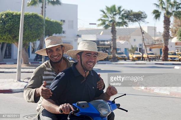 smiling on a motorbike in djerba - tunisia stock pictures, royalty-free photos & images