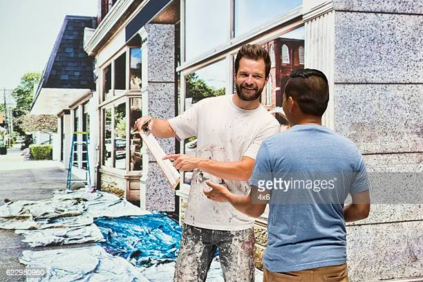 Smiling painter discussion with client
