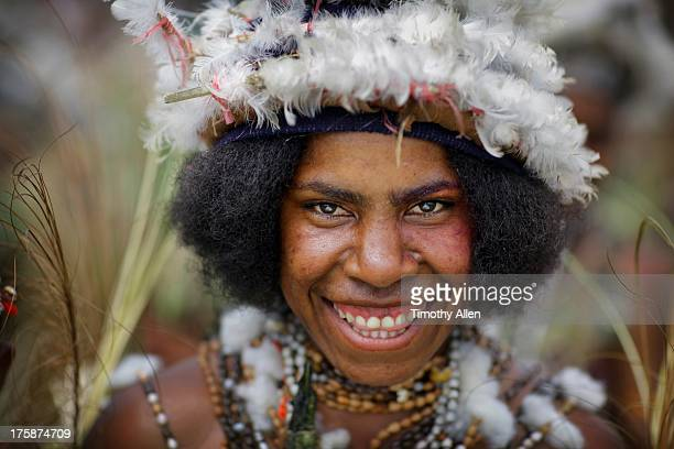 Smiling Papuan woman with feather headdress