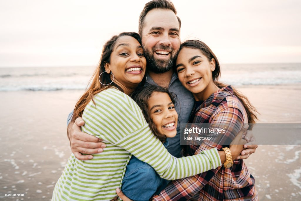Smiling parents with two children : Stock Photo