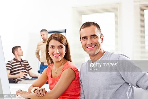 smiling people at work - izusek stock pictures, royalty-free photos & images