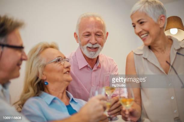 Smiling people having celebratory toast