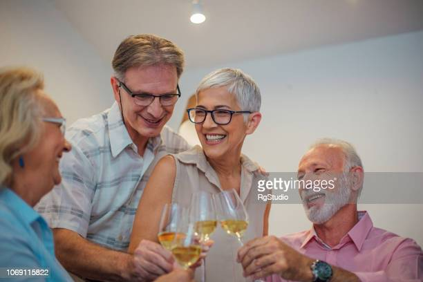 Smiling people having wine at home