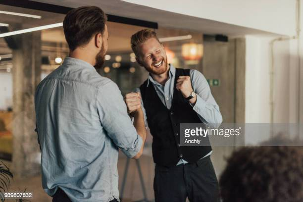 smiling people in business wear are shaking hands. - congratulating stock pictures, royalty-free photos & images