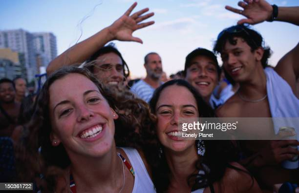 Smiling people in street carnival in Ipanema.