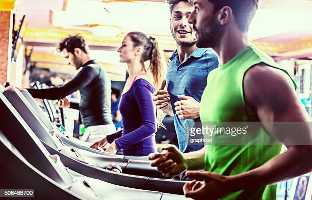 Smiling People Running on Treadmills in Gym