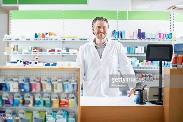 Smiling Pharmacist behind the counter
