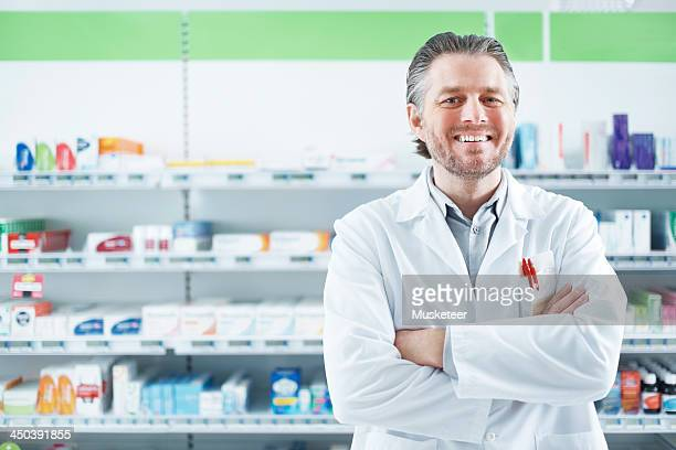 Smiling pharmacist looking into camera