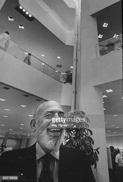 Smiling photo of Stanley Marcus founder of Neiman Marcus department stores probably in one of his stores