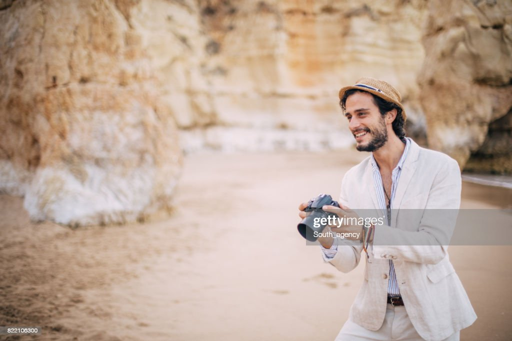Smiling Photographer at the beach : Stock Photo