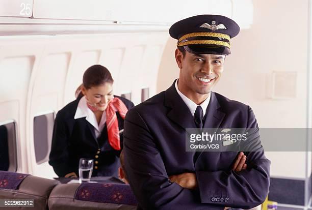 Smiling Pilot Aboard Plane