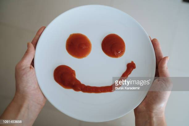 smiling plate - ketchup stock pictures, royalty-free photos & images