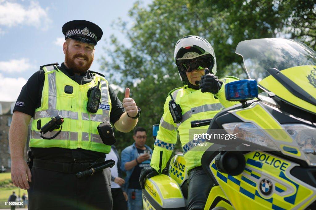 Smiling Police at an Edinburgh Parade : Stock Photo