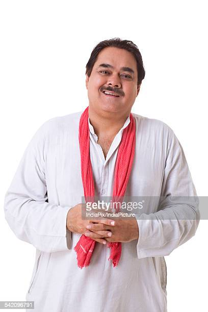 smiling politician standing over white background - kurta stock pictures, royalty-free photos & images