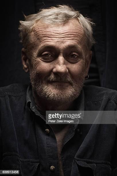 smiling portrait of a homeless senior man