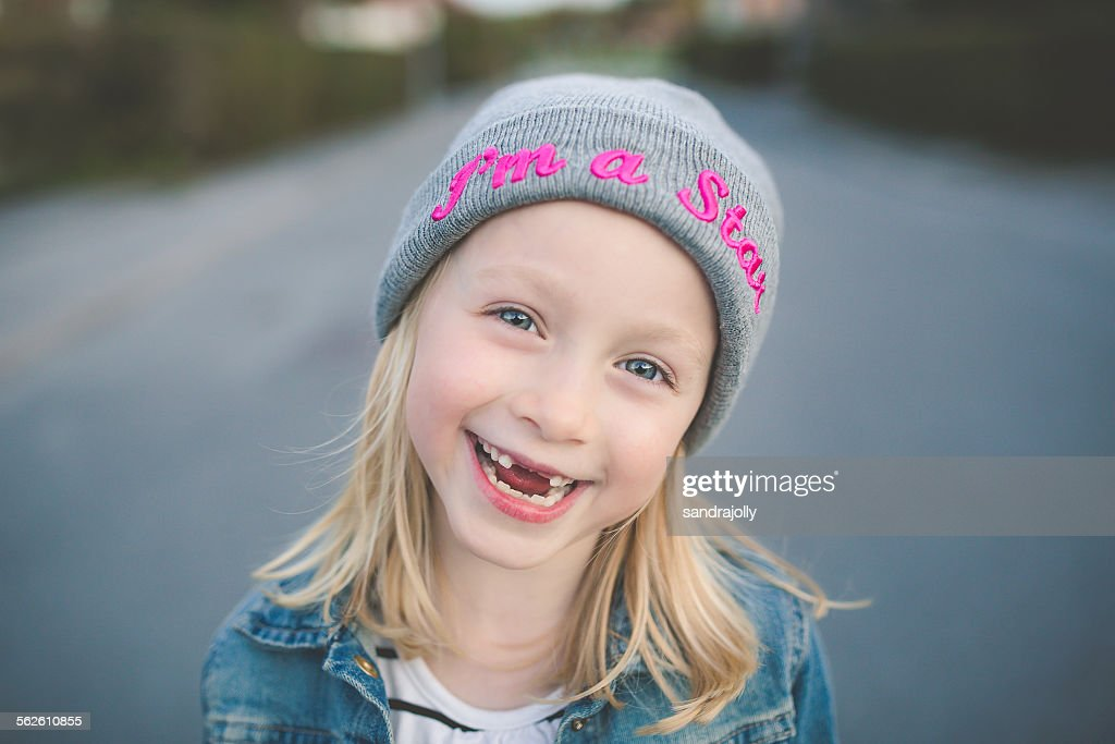 Smiling portrait of girl with her front teeth missing : Stock Photo