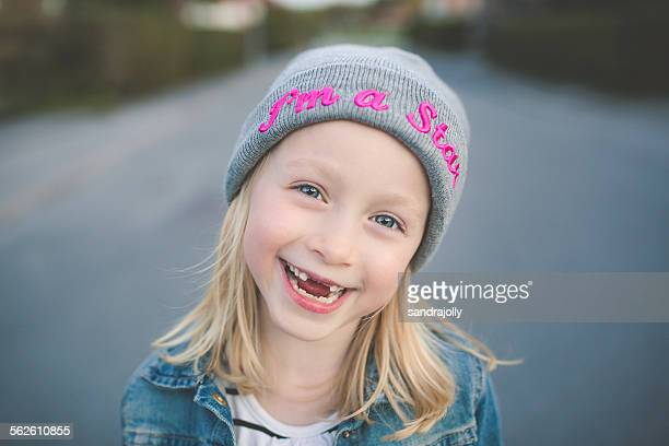 smiling portrait of girl with her front teeth missing - head cocked stock pictures, royalty-free photos & images