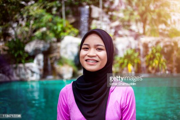Smiling portrait of young Malaysian woman in hijab