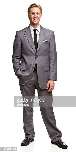smiling posing man in suit - grey suit stock pictures, royalty-free photos & images