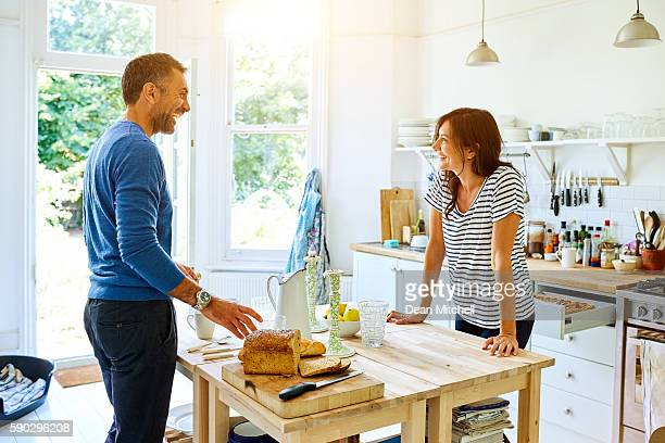 smiling pregnant couple preparing breakfast in kitchen - real wife sharing stock photos and pictures