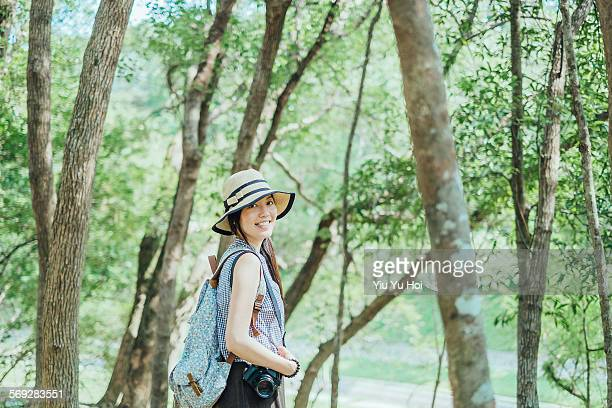 smiling pretty woman enjoys the calmness in woods - yiu yu hoi stock pictures, royalty-free photos & images