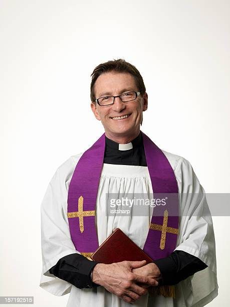 smiling priest - priest stock pictures, royalty-free photos & images