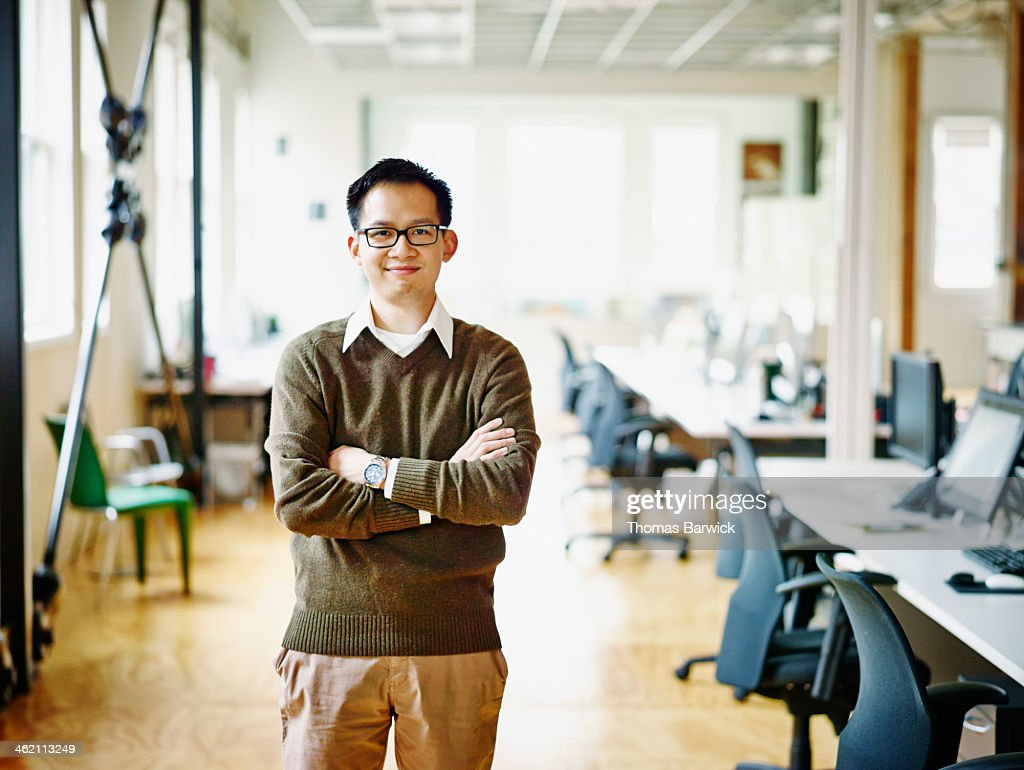 Smiling professional in high tech office : Stock Photo