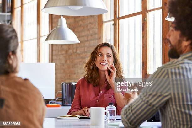 Smiling professional looking at coworker in office