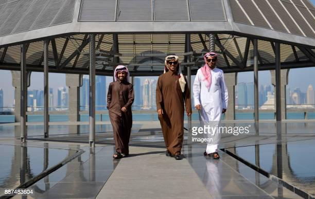 Smiling Qatari men