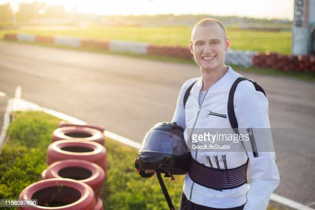 smiling race car driver - racing driver stock pictures, royalty-free photos & images