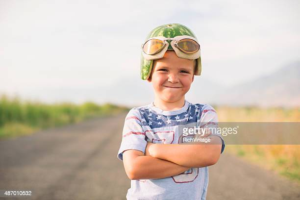 Smiling Racing Boy in Watermelon Helmet