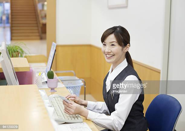 A smiling receptionist