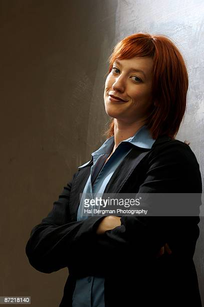 Smiling Redhead with Arms Crossed