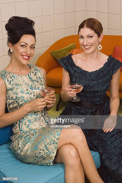 Smiling retro women with cocktails